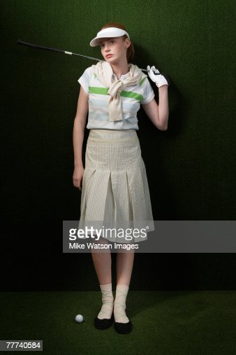 Golfer Holding Club Wearing Vintage Clothes : Stock Photo
