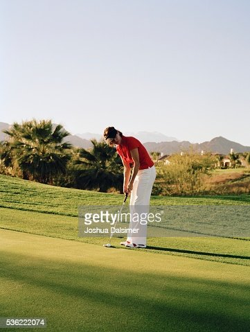 Golfer holding golf club : Stock Photo