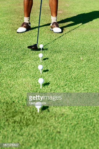A golfer holding his club ready to hit the golf ball