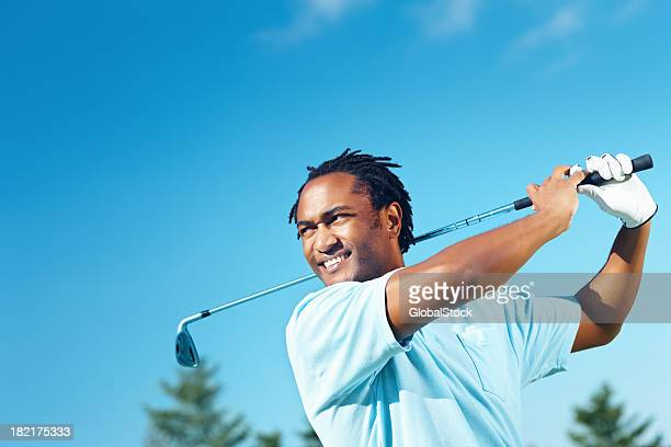 Golfer holding his finish after a great shot