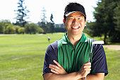 Golfer holding putter, portrait