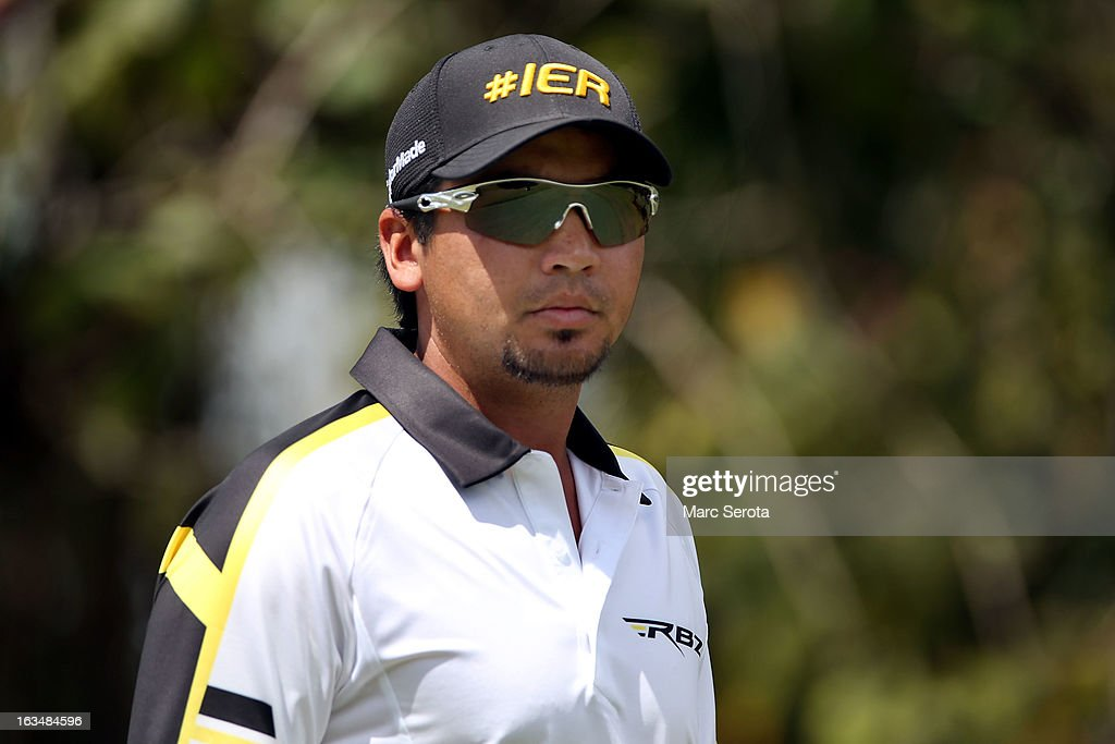 Golfer <a gi-track='captionPersonalityLinkClicked' href=/galleries/search?phrase=Jason+Day+-+Golfeur&family=editorial&specificpeople=4534484 ng-click='$event.stopPropagation()'>Jason Day</a> hits on the 12th fairway at the World Golf Championships-Cadillac Championship at the Trump Doral Golf Resort & Spa on March 10, 2013 in Doral, Florida.