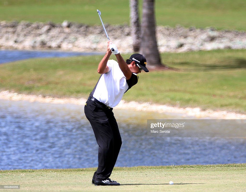 Golfer <a gi-track='captionPersonalityLinkClicked' href=/galleries/search?phrase=Jason+Day+-+Golfer&family=editorial&specificpeople=4534484 ng-click='$event.stopPropagation()'>Jason Day</a> hits on the tenth fairway at the World Golf Championships-Cadillac Championship at the Trump Doral Golf Resort & Spa on March 10, 2013 in Doral, Florida.