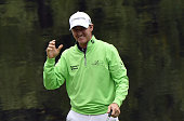 US golfer Jimmy Walker celebrates after putting on the 9th green during the Par 3 contest prior to the start of the 80th Masters of Tournament at the...