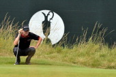 US golfer Jimmy Walker lines up his putt on the 3rd green during his fourth round on the final day of the 2014 British Open Golf Championship at...