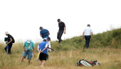 US golfer Jimmy Walker looks for his ball in the rough on the14th hole during his fourth round 73 on the final day of the 2014 British Open Golf...