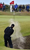 US golfer Jimmy Walker plays from a bunker on the 13th hole during his first round 72 on the opening day of the 2015 British Open Golf Championship...
