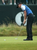 US golfer Jimmy Walker putts on the 3rd green during his third round on day three of the 2014 British Open Golf Championship at Royal Liverpool Golf...