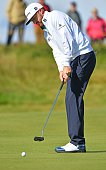 US golfer Jimmy Walker putts on the 4th Green during his first round on the opening day of the 2016 British Open Golf Championship at Royal Troon in...