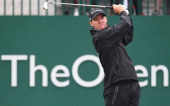 US golfer Jimmy Walker watches his shot from the 1st tee during his third round on day three of the 2014 British Open Golf Championship at Royal...
