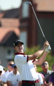 US golfer Jimmy Walker watches his shot from the 3rd tee during his first round on the opening day of the 2014 British Open Golf Championship at...