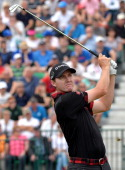 US golfer Jimmy Walker watches his shot from the 4th tee during his fourth round on the final day of the 2014 British Open Golf Championship at Royal...
