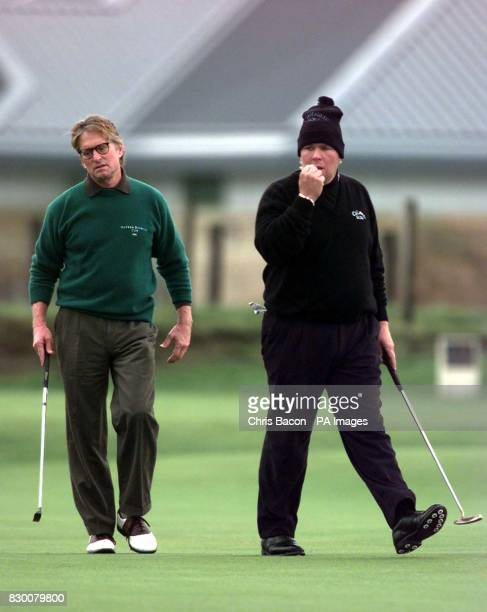 Golfer John Daly and actor Michael Douglas during a practice round today prior to the start of the Dunhill Cup at St Andrews tomorrow Photo by Chris...