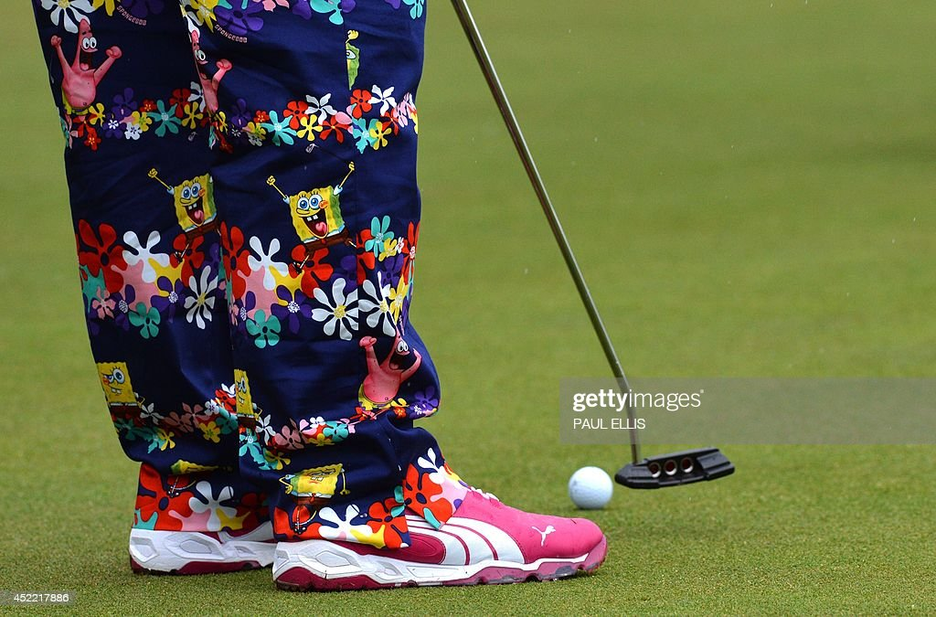 US golfer John Daly wearing his unusual colourful trousers on the practice green at Royal Liverpool Golf Course in Hoylake, north west England on July 16, 2014 ahead of The British Open Golf Championship.