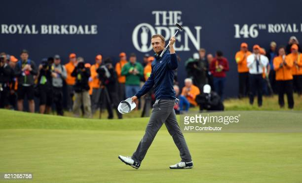 US golfer Jordan Spieth celebrates on the 18th green after his final round 69 to win the Championship on day four of the 2017 Open Golf Championship...