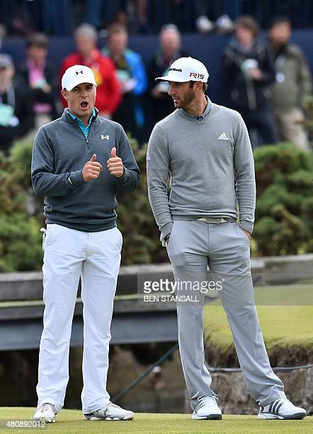US golfer Jordan Spieth gestures as he waits with US golfer Dustin Johnson on the 1st tee during his first round on the opening day of the 2015...