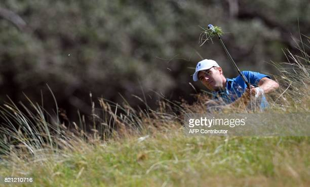 US golfer Jordan Spieth plays from the rough on the 1st hole during his final round on day four of the 2017 Open Golf Championship at Royal Birkdale...