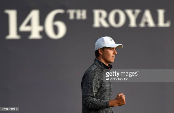 US golfer Jordan Spieth reacts to holing a putt on the 18th green after his third round on day three of the Open Golf Championship at Royal Birkdale...