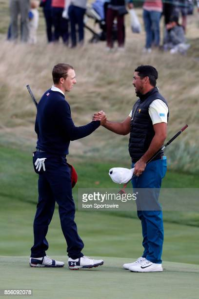 USA golfer Jordan Spieth shakes hands with International golfer Jason Day after winning the match on the 17th hole during the third round of the...