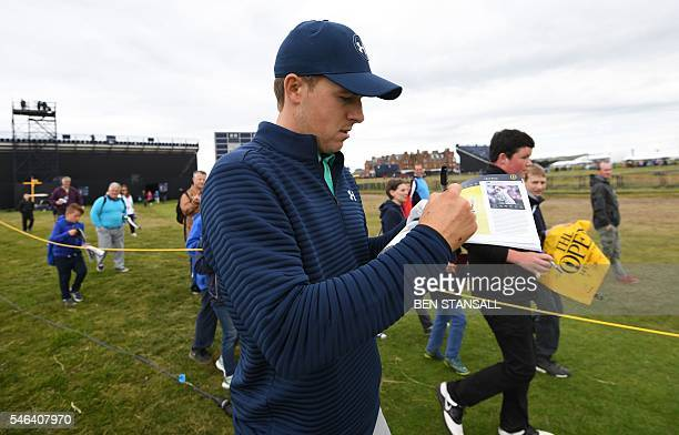 US golfer Jordan Spieth signs autographs while walking up the 2nd faitway during practice on July 12 ahead of the 2016 British Open Golf Championship...