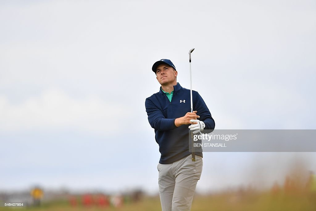 US golfer Jordan Spieth watches his approach shot on the 2nd hole during practice on July 12, 2016, ahead of the 2016 British Open Golf Championship at Royal Troon in Scotland. The 2016 British Open begins on July 14, 2016. The British Open returns to Royal Troon on Scotland's west coast this week with Rory McIlroy back in the field having been unable to defend the Claret Jug a year ago due to injury. / AFP / Ben STANSALL / RESTRICTED