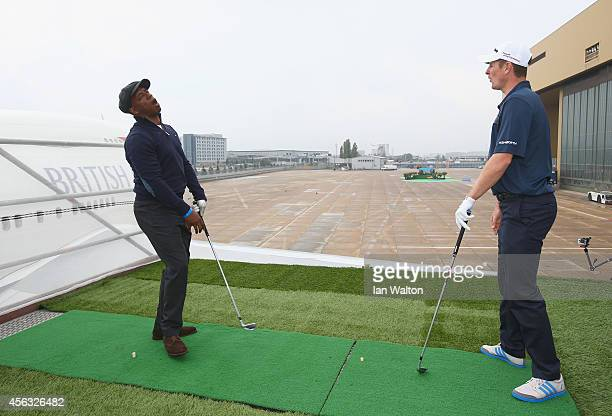 Golfer Justin Rose and Ian Wright plays a shot from the wing of a British Airways Boeing 747 to a target 180 yards away during an event to raise...