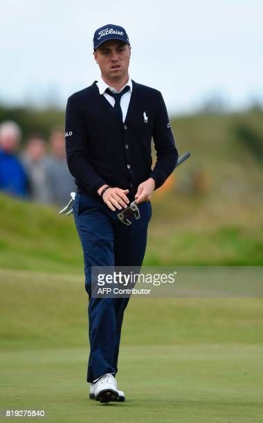 US golfer Justin Thomas reacts after putting on the 3rd green during his opening round on the first day of the Open Golf Championship at Royal...