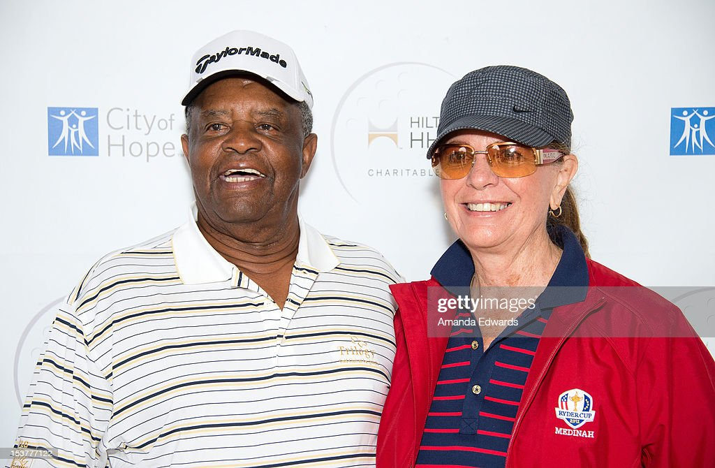 Golfer Lee Elder (L) and his wife arrive at the 6th Annual Hilton HHonors Charitable Golf Series at The Riviera Country Club on October 8, 2012 in Pacific Palisades, California.