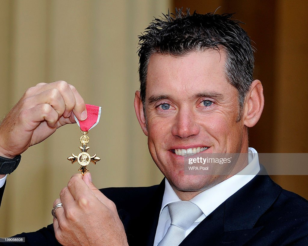 Golfer <a gi-track='captionPersonalityLinkClicked' href=/galleries/search?phrase=Lee+Westwood&family=editorial&specificpeople=171611 ng-click='$event.stopPropagation()'>Lee Westwood</a> smiles after he received his Officer of the British Empire (OBE) medal from Queen Elizabeth II during an Investiture ceremony at Buckingham Palace on February 16, 2012 in London, England.
