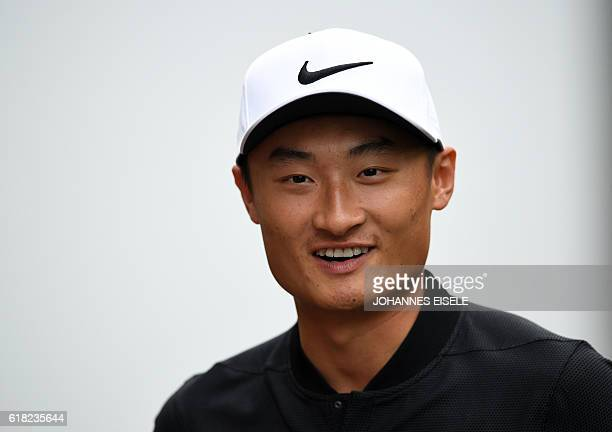 Golfer Li Haotong of China attends a press conference for the World Golf ChampionshipsHSBC Champions golf tournament in Shanghai on October 26 2016 /...