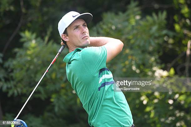 Golfer Mark Wilson follows his ball after teeing off on the number two hole during the first round of the John Deere Classic at TPC Deere Run in...