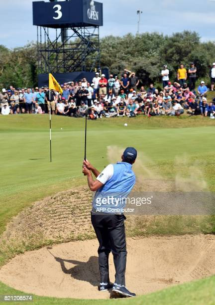 US golfer Matt Kuchar chips from a greenside bunker on the 3rd hole during his final round on day four of the 2017 Open Golf Championship at Royal...