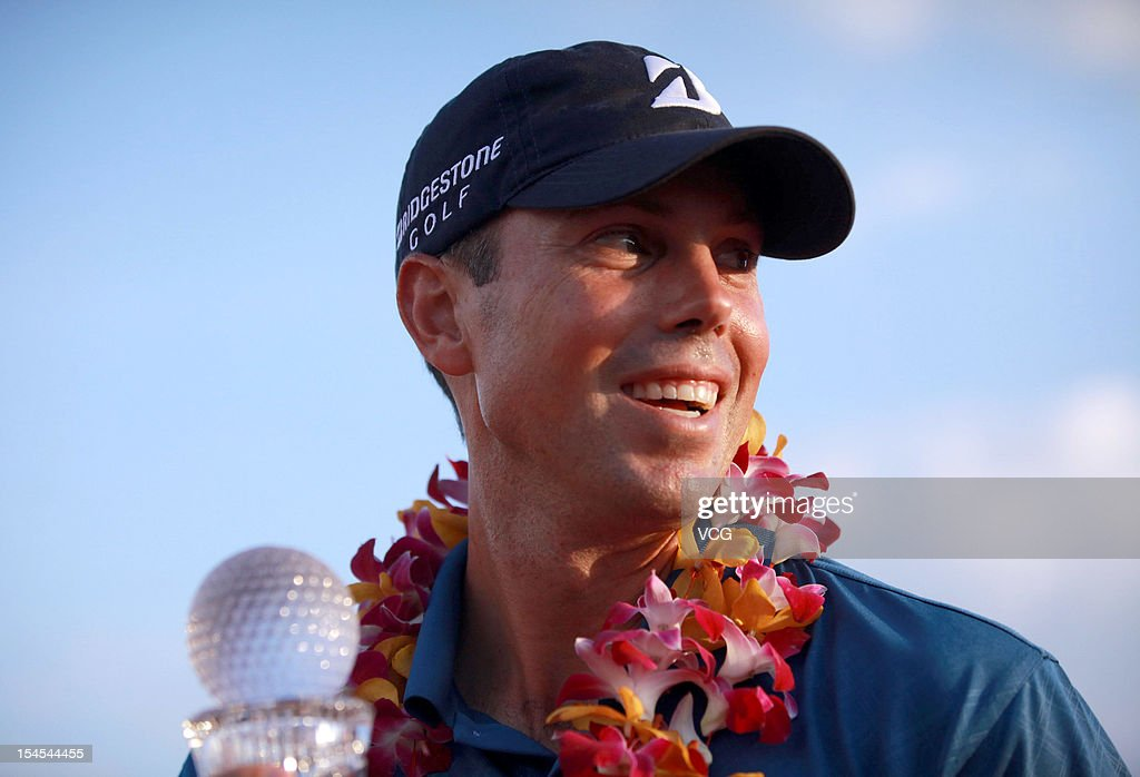 Golfer <a gi-track='captionPersonalityLinkClicked' href=/galleries/search?phrase=Matt+Kuchar&family=editorial&specificpeople=243226 ng-click='$event.stopPropagation()'>Matt Kuchar</a> of USA poses with the trophy after winning the Mission Hills Star Trophy at the Mission Hills Golf Club on October 21, 2012 in Haikou, China.