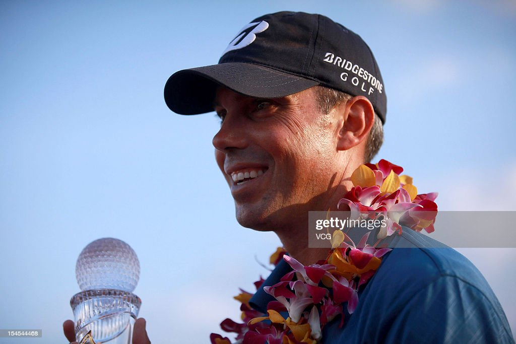 Golfer Matt Kuchar of USA poses with the trophy after winning the Mission Hills Star Trophy at the Mission Hills Golf Club on October 21, 2012 in Haikou, China.