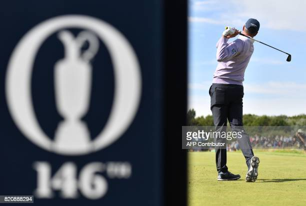 US golfer Matt Kuchar plays from the 4th tee during his third round on day three of the Open Golf Championship at Royal Birkdale golf course near...