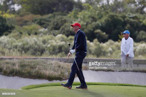USA golfer Matt Kuchar plays the 14th hole during the third round of the Presidents Cup at Liberty National Golf Club on September 30 2017 in Jersey...