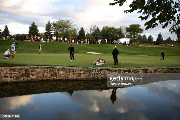 USA golfer Matt Kuchar putts on the 2nd hole during the third round of the Presidents Cup at Liberty National Golf Club on September 30 2017 in...