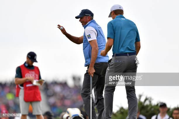 US golfer Matt Kuchar reacts to making birdie on the 9th green as US golfer Jordan Spieth makes a bogey during their final rounds on day four of the...