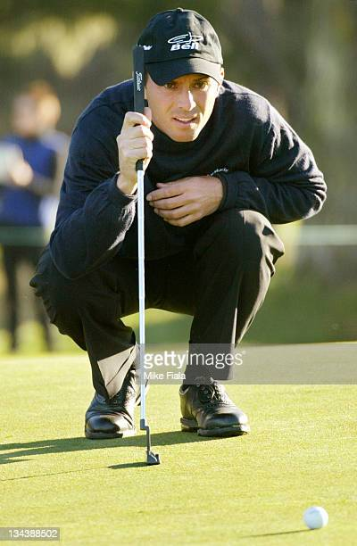 Golfer Mike Weir linesup a putt on the 1st green at Spyglass Hill golf course during the ATT Pebble Beach National ProAm golf tournament in Pebble...