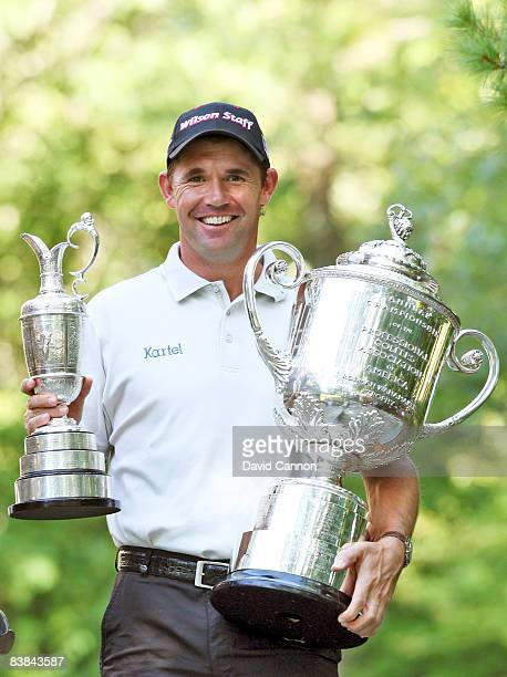 Golfer Padraig Harrington of Ireland poses with the Claret Jug and Wanamaker Trophy following his wins in the 137th Open Championship at Royal...