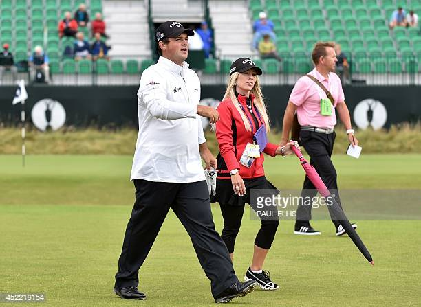 US golfer Patrick Reed and his wife Justine leave the 4th tee during a practice round at Royal Liverpool Golf Course in Hoylake north west England on...