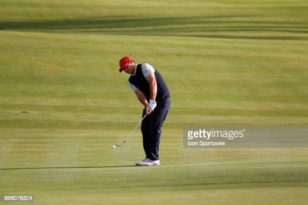 USA golfer Patrick Reed chips on the 4th hole during the third round of the Presidents Cup at Liberty National Golf Club on September 30 2017 in...