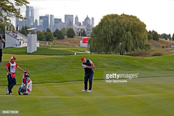 USA golfer Patrick Reed chips on the 5th hole during the third round of the Presidents Cup at Liberty National Golf Club on September 30 2017 in...