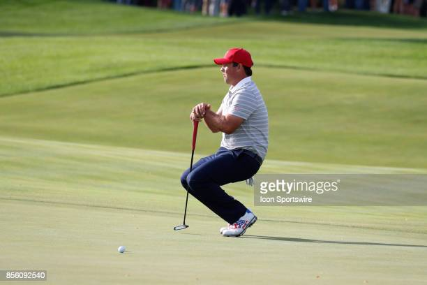 USA golfer Patrick Reed reacts to missing a putt on the 8th hole during the third round of the Presidents Cup at Liberty National Golf Club on...