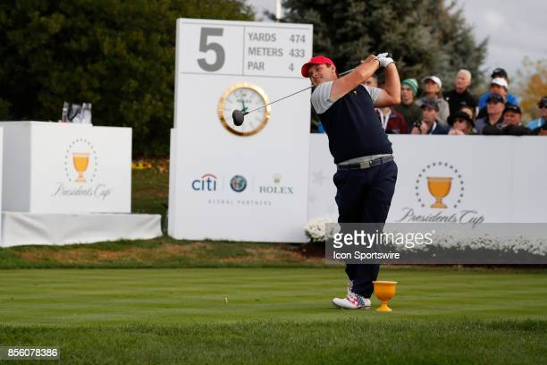 USA golfer Patrick Reed tees off on the 5th hole during the third round of the Presidents Cup at Liberty National Golf Club on September 30 2017 in...