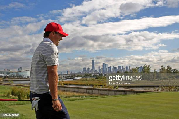 USA golfer Patrick Reed walks to the 14th tee with the New York city skyline in the background during the third round of the Presidents Cup at...