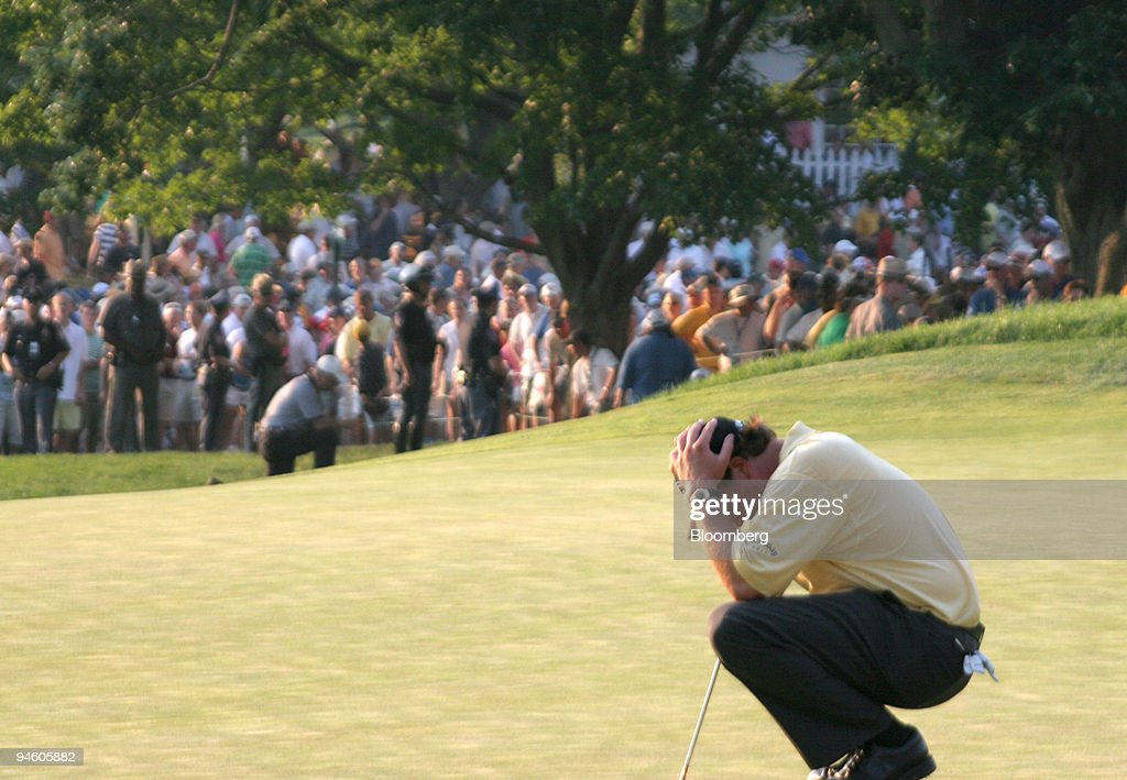 Golfer Phil Mickelson holds his head in his hands June 18 after missing a bogey putt on the 72nd and final hole of the US Open at Winged Foot Golf...