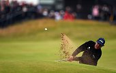 US golfer Phil Mickelson plays from a greenside bunker on the 18th hole during his third round 70 on day three of the 2016 British Open Golf...
