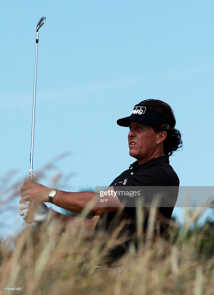 US golfer Phil Mickelson plays from seventh tee at Muirfield golf course at Gullane in Scotland on July 15, 2013 ahead of The 2013 Open Golf Championship. AFP PHOTO/Peter MUHLY