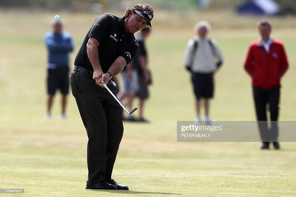 US golfer Phil Mickelson plays from the seventh fairway at Muirfield golf course at Gullane in Scotland on July 15, 2013 ahead of The 2013 Open Golf Championship. AFP PHOTO/Peter MUHLY